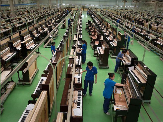 Fábrica de Xinghai Piano Group en Pekín, donde se hacen unos 30000 pianos al año